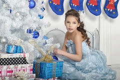 Girl  near a Christmas tree Stock Photo