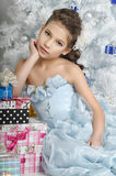 Girl  near a Christmas tree Stock Photography