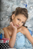 Girl  near a Christmas tree Royalty Free Stock Photos