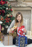 Girl near the Christmas tree with beautiful gifts Royalty Free Stock Photos