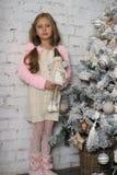 Girl near the Christmas tree Stock Image