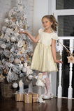 Girl near the Christmas tree Stock Photo