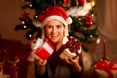 Girl near Christmas tree holding present boxes Royalty Free Stock Image