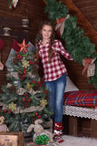 Girl near the Christmas tree Stock Images