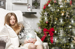 Girl near Christmas tree Stock Photography