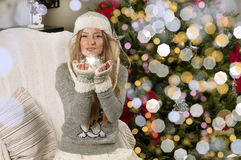 Girl near Christmas tree Stock Photos