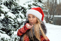 Girl near Christmas tree with snow Royalty Free Stock Photo