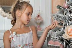Girl near the Christmas tree Royalty Free Stock Photos