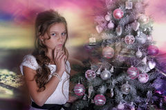 Girl  near Christmas tree Royalty Free Stock Images