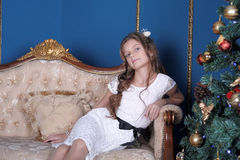 Girl  near Christmas tree Stock Images