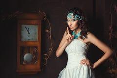 Girl near the clock. Stock Photos
