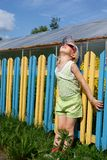 Girl near a colour fence Royalty Free Stock Images