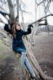 Girl near the curvy tree. Photo of a girl near the curvy tree Stock Photos