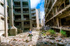 Girl Near Destroy Building Structures during Daytime Royalty Free Stock Image