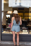 Girl near display window Royalty Free Stock Photo