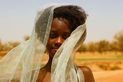 African school girl. Wearing a veil Stock Images