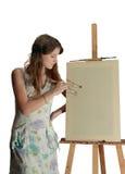 Girl near easel Stock Images