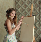 Girl near easel Royalty Free Stock Photos