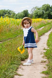 Girl  near a field of blossoming sunflowers Royalty Free Stock Photos