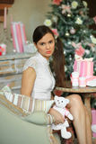 The girl near a fir-tree with pink gifts Royalty Free Stock Photos