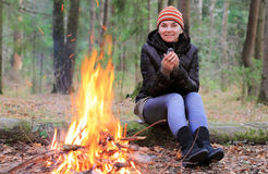 Girl near the fire Stock Photography