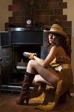 Girl near the fireplace Stock Photography