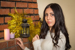 Girl near the fireplace. And candles Stock Photos