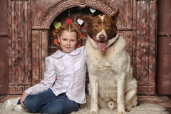 Girl with dog near the fireplace Stock Photos