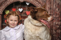 Girl with dog near the fireplace Stock Photography