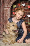 Girl with dog near the fireplace Royalty Free Stock Images
