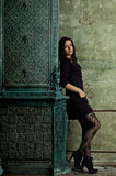 Girl near a fireplace with patterns Royalty Free Stock Photography