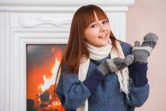 Girl near fireplace Royalty Free Stock Photos
