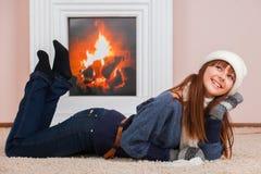 Girl near fireplace Stock Photos