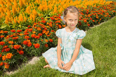 Girl Near Flowerbed Royalty Free Stock Photo