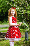 Girl  near a flowering bush. Girl in a beautiful dress near a flowering bush Stock Photography