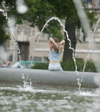 Girl near fountain. Near the fountain. Young woman Royalty Free Stock Photography