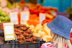 girl near fruits and vegetables in market Royalty Free Stock Photo