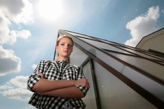 Girl near glass pyramid. Beautiful girl near glass pyramid under sun in blue sky with clouds Stock Photography