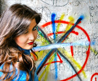 Girl near a graffiti Stock Photography