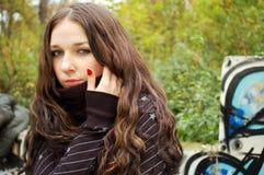 Girl near the graffiti wall. Teenage girl near the graffiti wall Royalty Free Stock Images