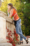 Girl near handrails. Girl stands near the old broken handrails Stock Photo