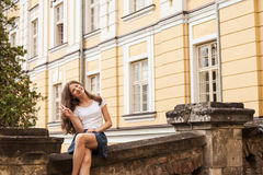 Girl near the hight school building Royalty Free Stock Photography