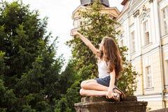 Girl near the hight school building Royalty Free Stock Photo