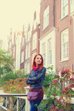Girl near houses in Amsterdam. Royalty Free Stock Image