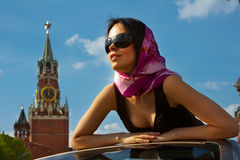 Girl near Kremlin , Moscow. Girl in cabriolet on the red square near the Kremlin in Moscow, blue sky and shiny weather royalty free stock image
