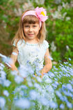 Girl near the lilac bushes Stock Image