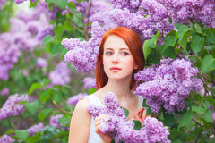 Girl near lilac tree Royalty Free Stock Images