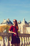 Girl near Luxembourg Palace. Redhead girl near Luxembourg Palace in Paris stock images