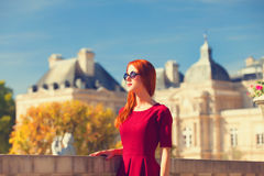 Girl near Luxembourg Palace. Redhead girl near Luxembourg Palace in Paris royalty free stock images