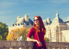 Girl near Luxembourg Palace. Redhead girl near Luxembourg Palace in Paris royalty free stock photos